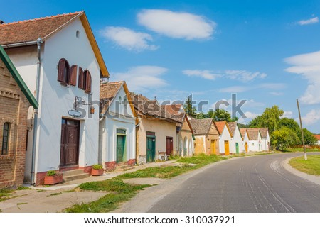 A traditional old street from Villany, Baranya county, Hungary full with wineries, vineyards and wine cellars. - stock photo