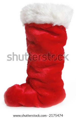 A traditional red Christmas stocking over white - stock photo