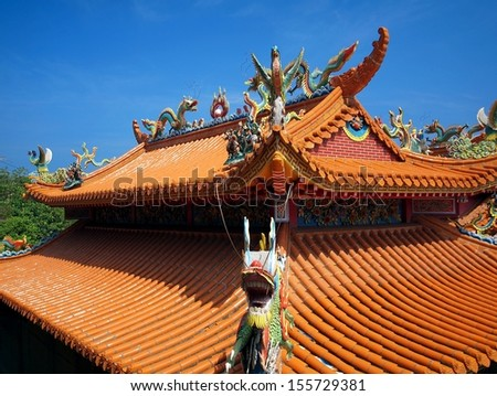 A traditional temple in Taiwan decorated with mythological beasts - stock photo