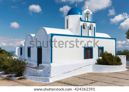 A traditional white and blue church on the Santorini island, Greece, Europe - stock photo