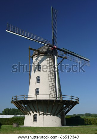 A traditional windmill near Ghent, Belgium - stock photo