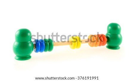 A traditional wooden abacus toy with two green matreshkas
