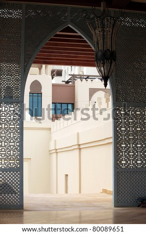A traditionally arched Arabian doorway and architecture in Doha, Qatar - stock photo