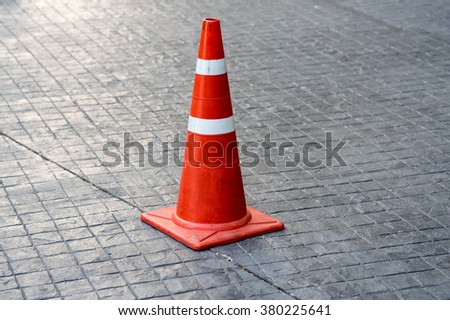 A traffic cone in Thailand. - stock photo