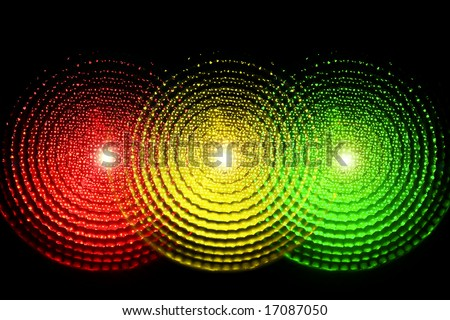A traffic light with all three lights lit simultaneously - stock photo