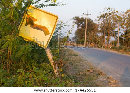 A traffic Signs worn-out in sunset at evening - stock photo