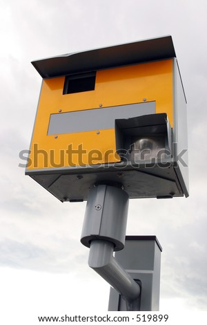 A traffic speed enforcement camera facing left. - stock photo
