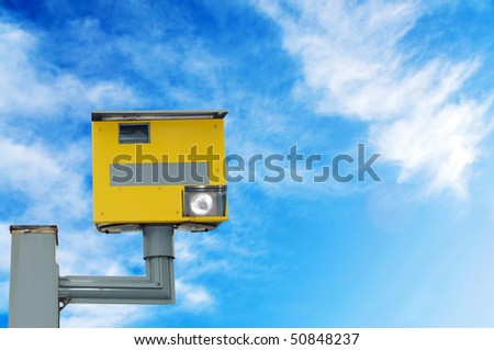 A traffic speed monitoring camera, against a bright blue sky. With space for your text / editorial overlay - stock photo