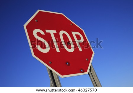 A traffic stop sign against blue sky.