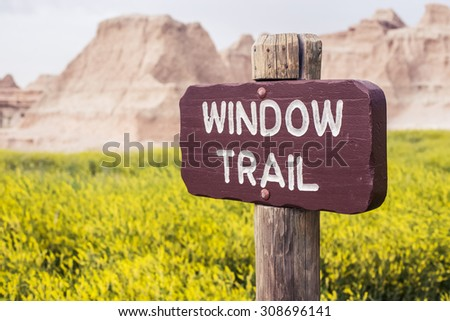A trail sign at Badlands National Park in the Black Hills of South Dakota, USA. - stock photo