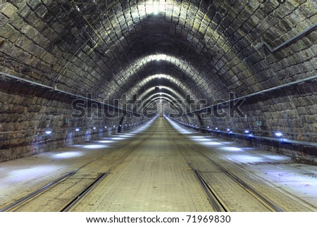 A train disappearing into a tunnel - stock photo