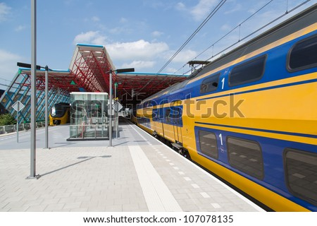 A train is leaving the central station of Lelystad, the Netherlands - stock photo