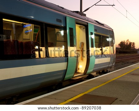 A train on an empty platform waiting for passengers - stock photo