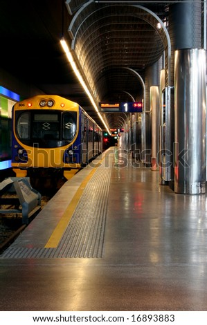 A train parked in an underground train station - stock photo