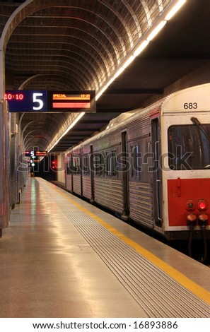 A train parked in an underground train station ready to depart - stock photo