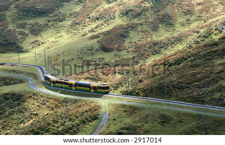 A train traveling up into the mountains - stock photo