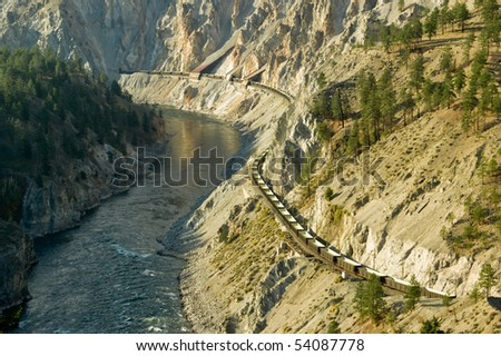 A train winds it's way through the Fraser Canyon north of Lytton, BC Canada. - stock photo