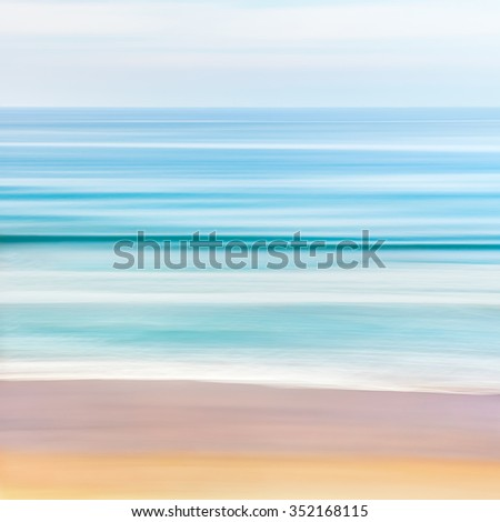 A tranquil, blurred, abstract seascape of the Pacific ocean off the coast of California.  Image features two contrasting waves captured with a long exposure. - stock photo