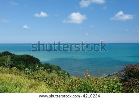 A tranquil picture of Lake Michigan from a hill in the city of Milwaukee Wisconsin - stock photo