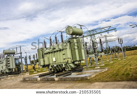 A transformer station in the east of Germany. (all scripts and logos blurred) - stock photo