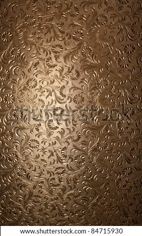 A translucent window pane with brown glass and textured floral pattern. - stock photo