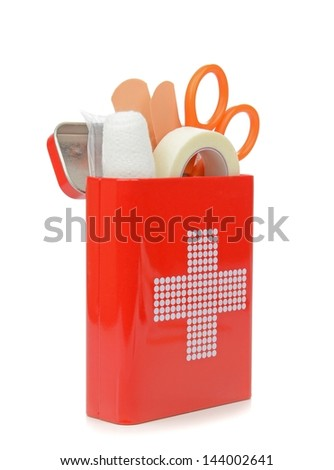 A travel first aid kit in a tin standing on a white background - stock photo