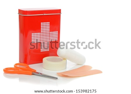 A travel first aid kit tin with contents on a white background - stock photo