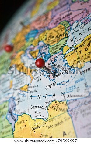 A travel or in-the-news concept, map of the world with a pin marking the area of Athens Greece. - stock photo