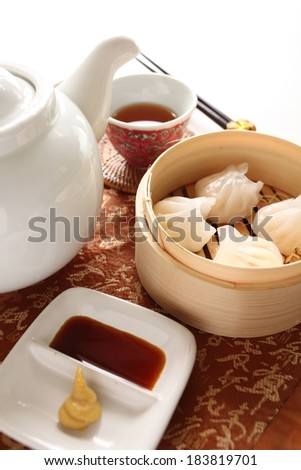 A tray containing food and tea with chop sticks. - stock photo