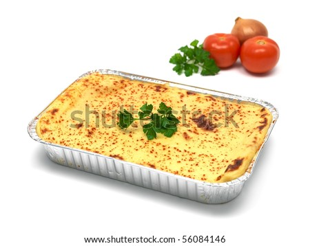 A tray of lasagna isolated against a white background - stock photo