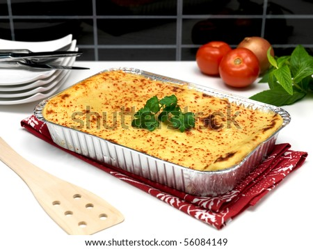 A tray of lasagna ready for plating - stock photo