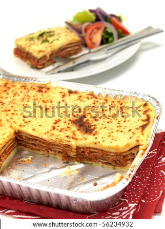 A tray of lasagne isolated against a white background - stock photo