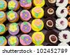 A tray of variety of colourful cupcakes for catering. - stock photo
