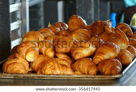 A tray with fresh croissant puff pastry at a local bakery