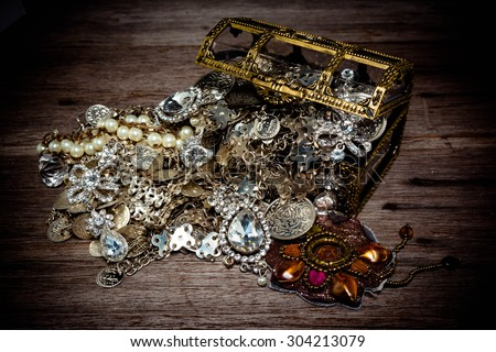 A treasure chest filled Silver and jewelery, Vintage style, still life