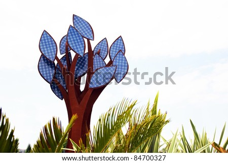 a tree with leaves of solar collectors. alternative energy - stock photo
