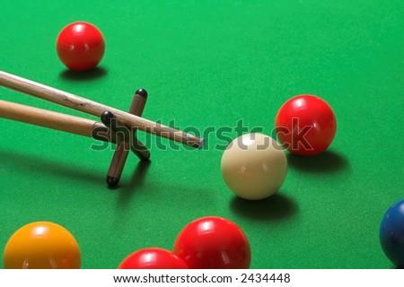 A tricky snooker shot, taken on a rest - stock photo