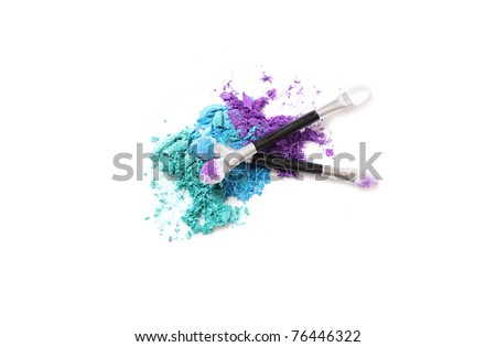 A trifecta of brightly colored eyeshadows, with traditional sponge-tipped applicators. Isolated on white.