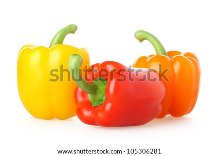 A trio of brightly colored capsicums - stock photo