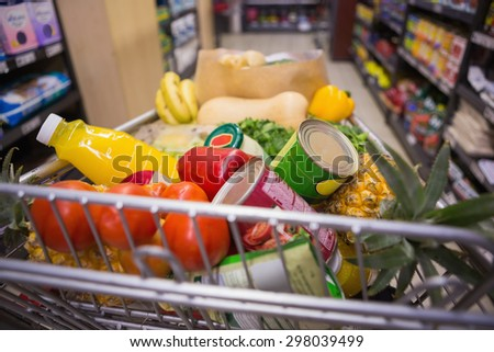 A trolley with healthy food at supermarket - stock photo