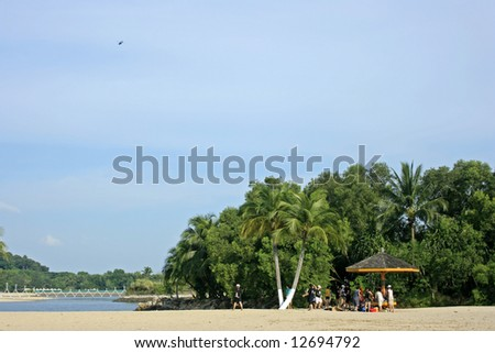 A tropical beach resort - stock photo