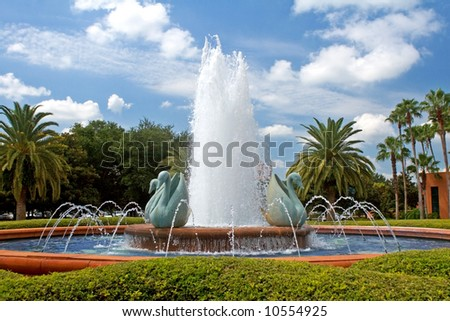 A tropical resort fountain on a sunny summer morning. - stock photo