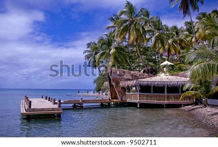 A tropical retreat getaway hut and pier - stock photo