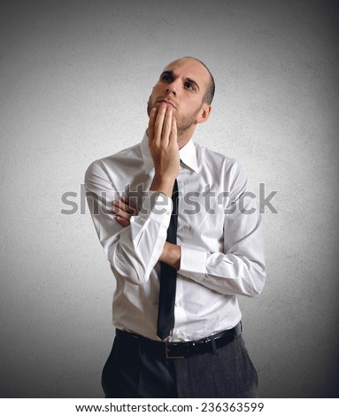 A troubled businessman thinks his work projects - stock photo
