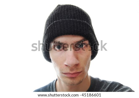 A troubled teenager stares intensely at the viewer, isolated on white background. - stock photo