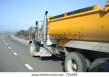 A truck drives on the freeway. - stock photo