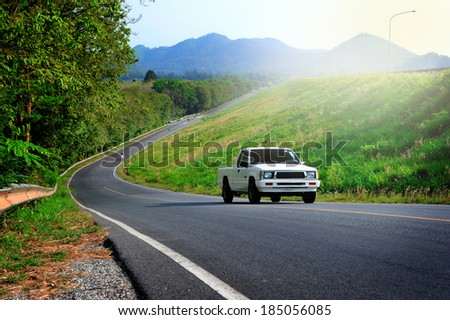 a truck running on the road  - stock photo