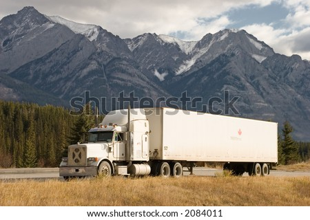 a truck stops in a rest area in the Canadian Rockies - stock photo