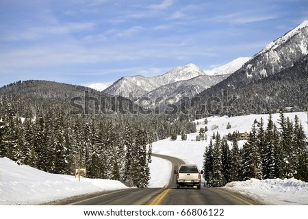 A Truck Traveling on a Highway in Montana in Winter - stock photo