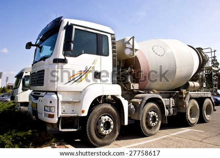 A truck with concrete mixer. It's used for shipping raw concrete to construction sites.